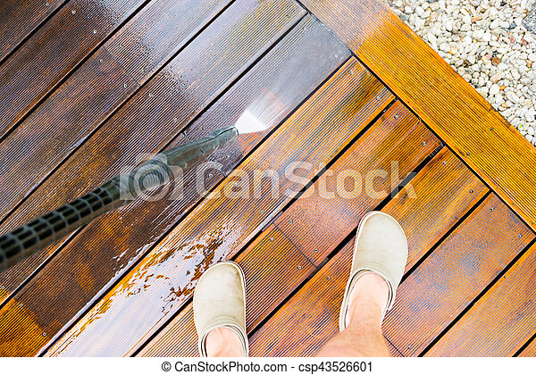 cleaning terrace with a pressure washer - csp43526601