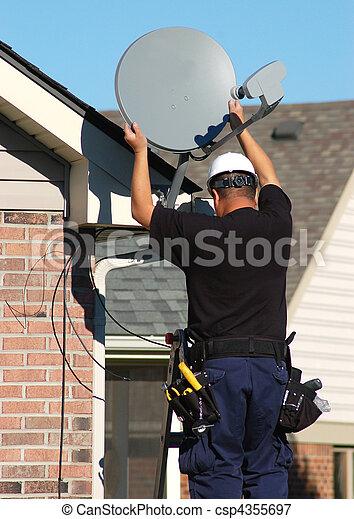 Satellite dish worker - csp4355697