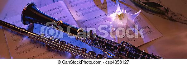 Clarinet on sheet music 2 - csp4358127