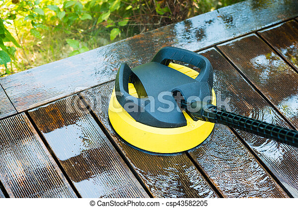 cleaning terrace with a pressure washer - csp43582205