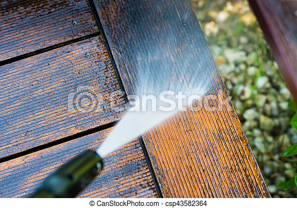 cleaning terrace with a pressure washer - csp43582364