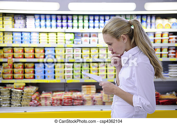 woman reading her shopping list in the supermarket - csp4362104