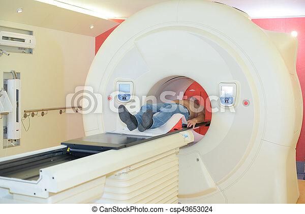 Man entering scanner tunnel