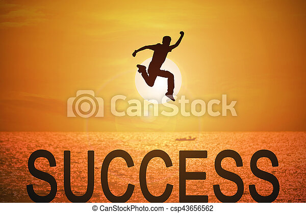 Silhouette of young man jumping over the success words with beautiful sunset at the sea background, concept for success and victory in business.