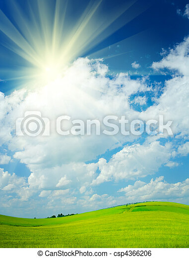 field and cloudy sky and sun on a rural scene - csp4366206