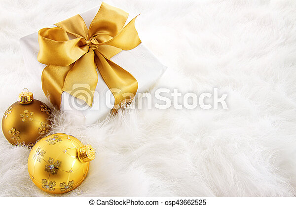 Gold ribboned gifts with christmas ornaments - csp43662525