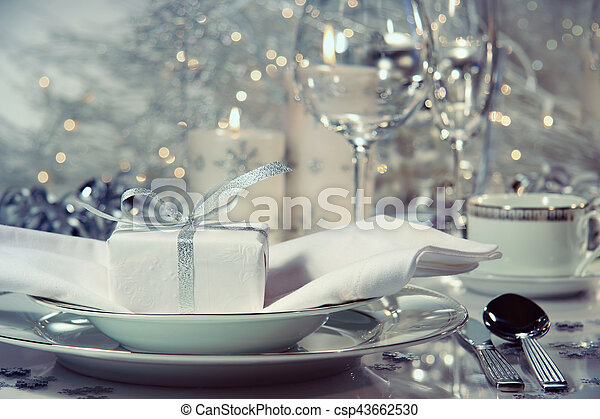 Closeup of dinner setting with gift for the holidays - csp43662530