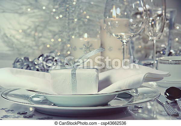 Festive dinner setting with gift - csp43662536