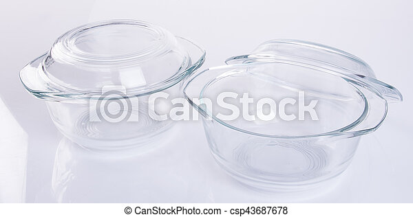 glass pot or glass casserole with lid for baking on a background