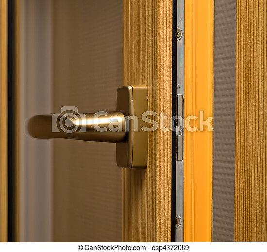 Window handle on fiberglass window. Gold color. - csp4372089