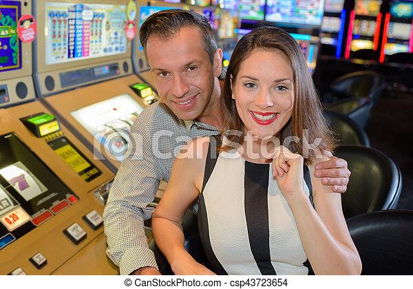 posing next to slot machine - csp43723654