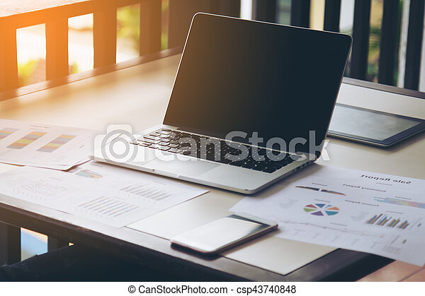 Business concept area work have laptop, chart and smart phone. The blank screen with copy space for your text or advertising content. Selective focus and soft flare filter.