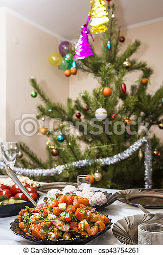 Salads and appetizers. Banquet in the restaurant. Focused on one dish. Against the background of Christmas trees with toys. New Year