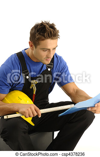 Young worker reading instructions - csp4378236