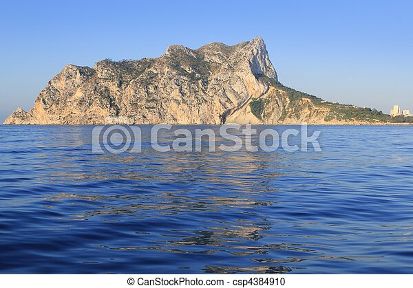 Ifach Penon mountain in Calpe from blue sea - csp4384910