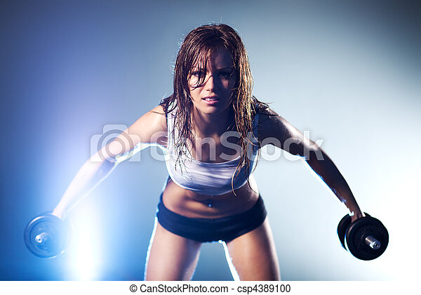 Young strong sexy woman with dumbbells - csp4389100