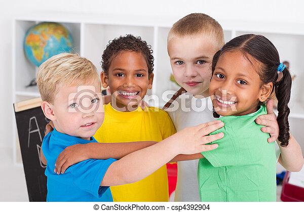 happy preschool kids hugging - csp4392904