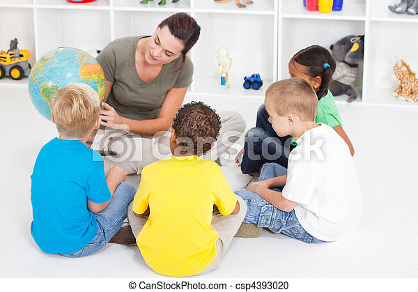 preschool teacher teaching kids - csp4393020