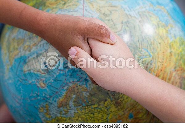kids handshake on globe - csp4393182