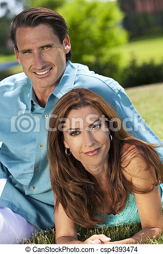 Happy Middle Aged Man and Woman Couple Outside Smiling - csp4393474