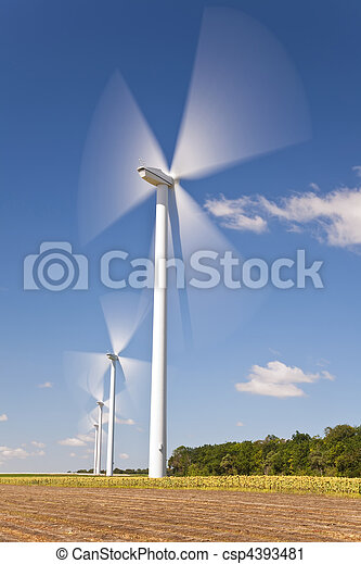 Green Energy Wind Turbines In Field of Sunflowers - csp4393481
