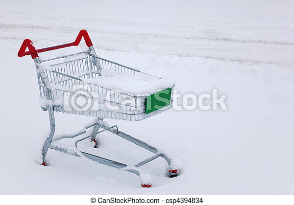 Shopping trolley in the snow - csp4394834