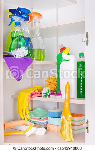 Cleaning supplies and tools arranged on shelves in storage place