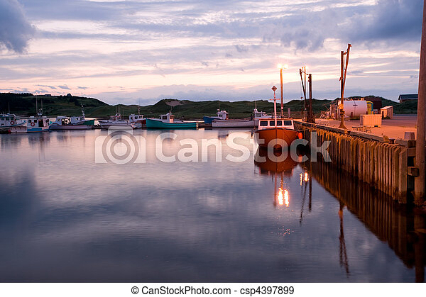 Sunset over harbor - csp4397899