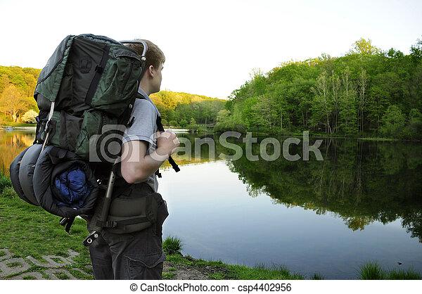 Teenage hiker standing by Sunrise Lake - csp4402956