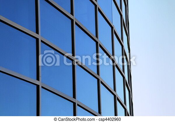 Curved exterior windows of a modern commercial office building  - csp4402960