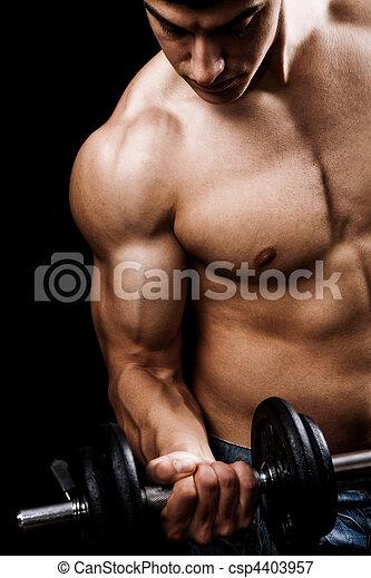 Powerful muscular man lifting weights - csp4403957