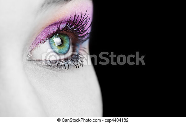 Close up on female eye with colorful make up - csp4404182