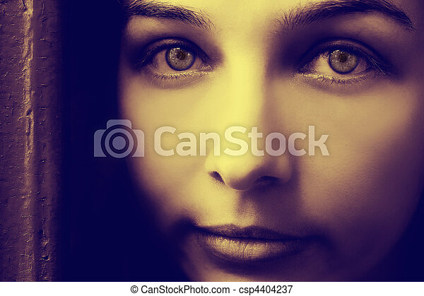 Artistic portrait of mystery woman with spooky eyes - csp4404237