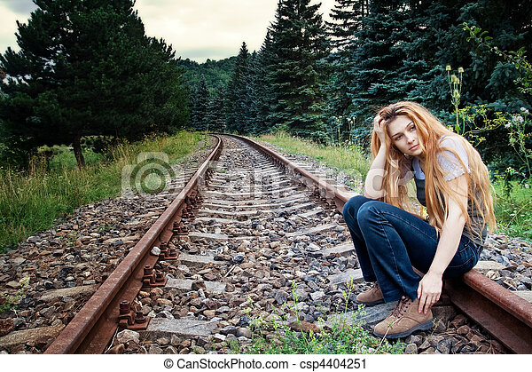 Sad suicidal lonely woman on railway track - csp4404251
