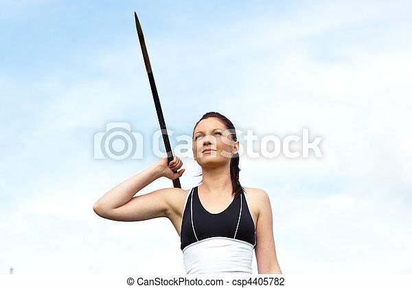 Female athlete throwing the javelin - csp4405782