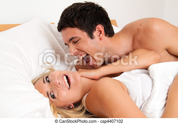 Couple has fun in bed. Laughter, joy and eroticism - csp4407102
