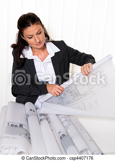 Architect with blueprint in the office. Squares ne of the residence. - csp4407176