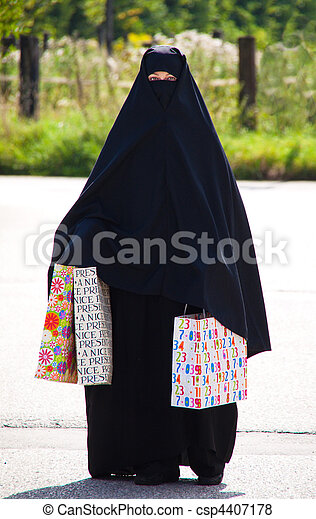 Example picture Islam. Muslim veiled woman with Burqa - csp4407178