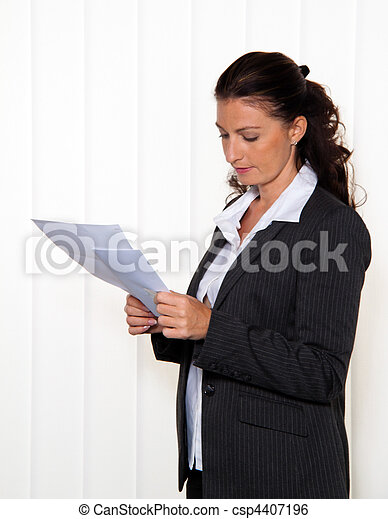 Businesswoman reading a letter - csp4407196
