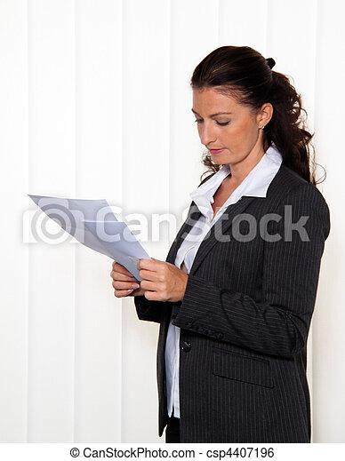 Businesswoman reading a letter - csp4407196