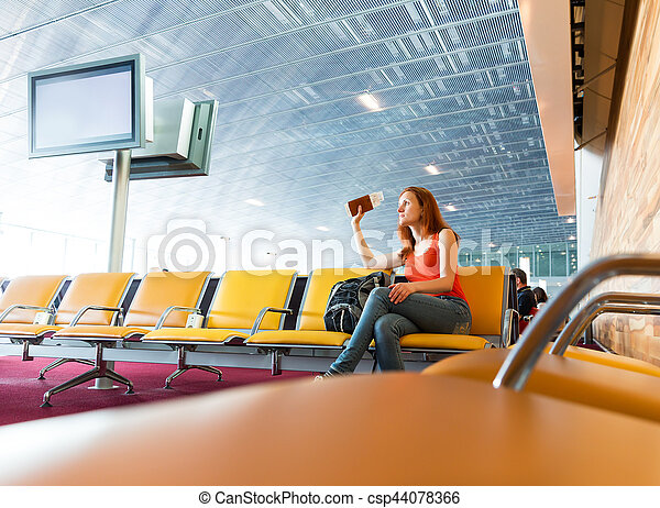 Young girl with ticket in hands waiting for departure.