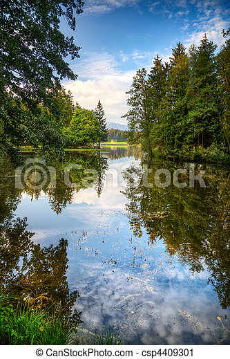 Alps lake and wild forest - csp4409301