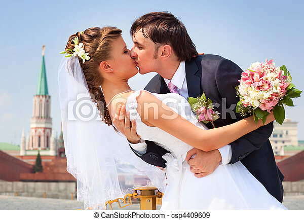 Young wedding couple kissing - csp4409609