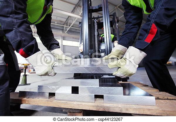 Workers taking aluminium billet - csp44123267