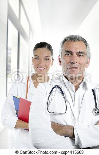expertise gray hair doctor beautiful nurse hospital - csp4415663