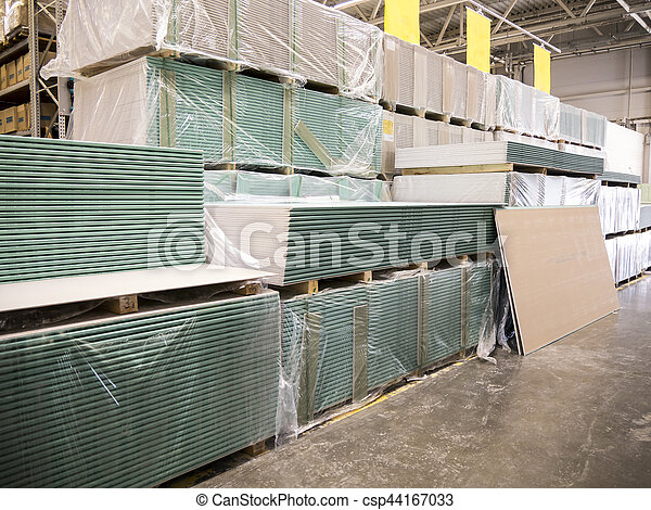 Large furniture warehouse of industial store. Warehouse of building materials shop