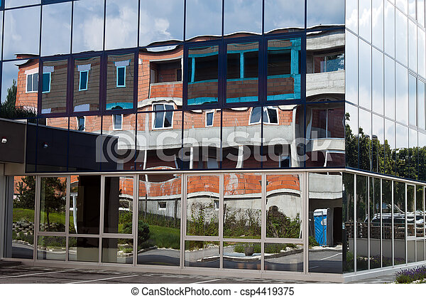 Shell of a house reflected in the facade - csp4419375