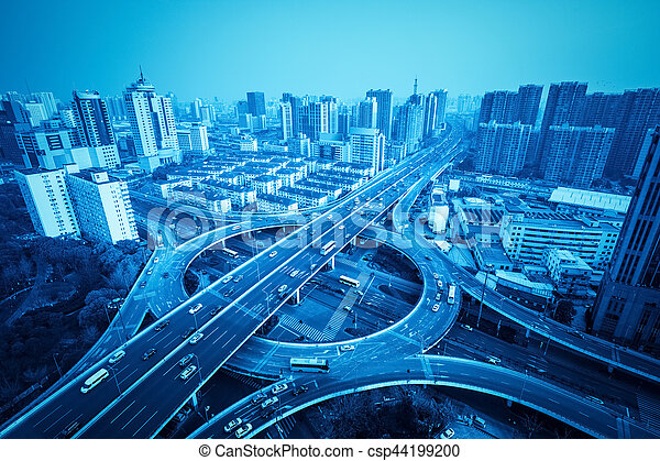city overpass in shanghai with blue tone, circular flyover and traffic light intersection