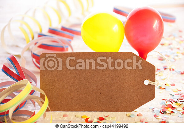 One Label With Copy Space For Advertisement. Party Decoration Like Streamer, Confetti And Balloons. Wooden Background With Vintage, Retro Or Rustic Syle