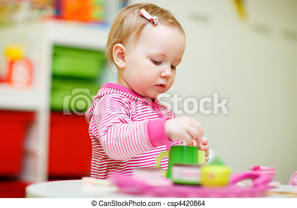Toddler girl playing with toys - csp4420864
